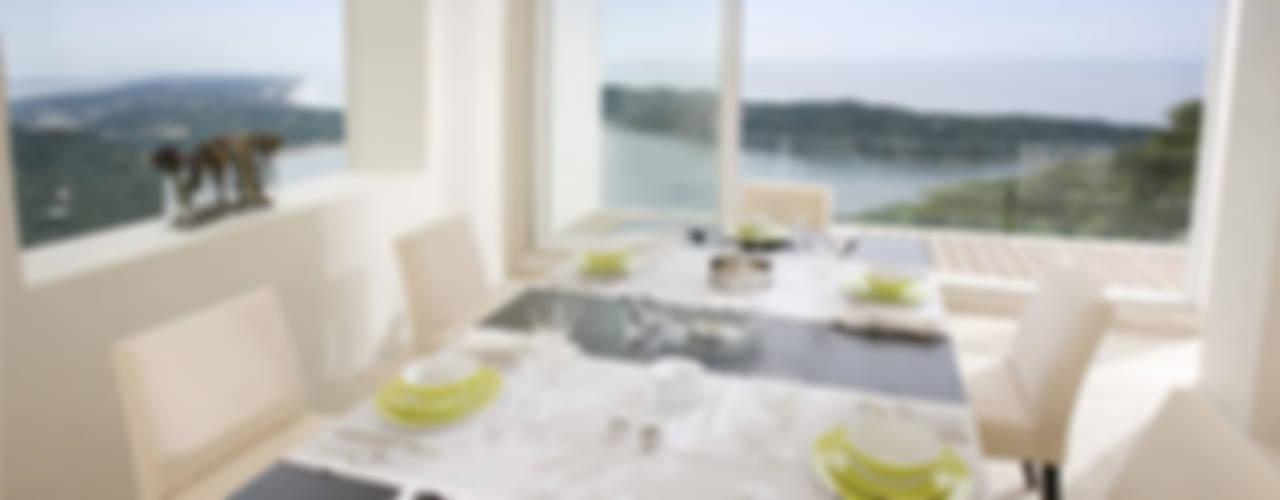 Casa blanca Comedores modernos de BNKR Arquitectura Moderno