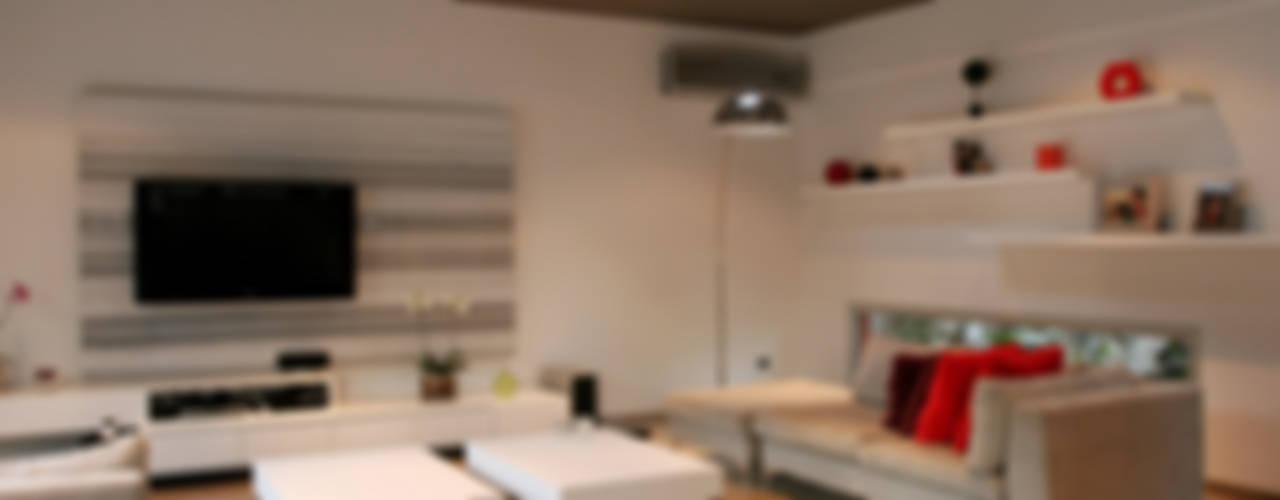 Salas de estar minimalistas por ESTUDIO GEYA Minimalista