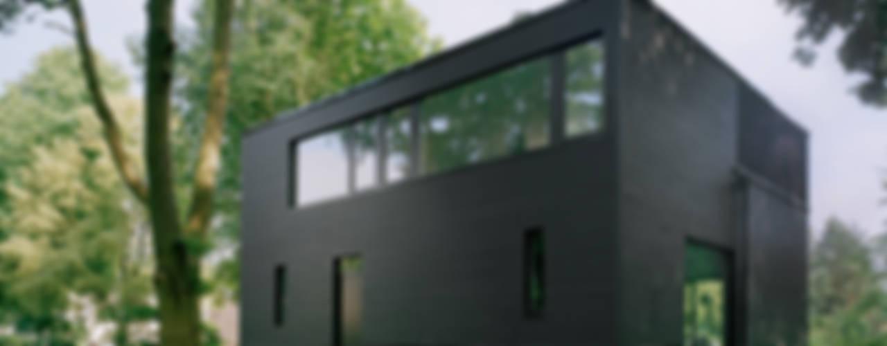 IOX Architekten GmbH Casas de estilo minimalista