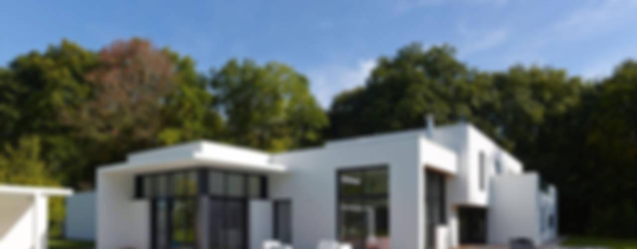 Moderne huizen van ATELIER D'ARCHITECTURE ET D'URBANISME MARTIAL Modern