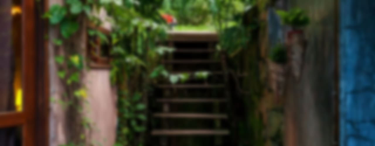 Casa da Floresta: Corredores e halls de entrada  por Ferraro Habitat