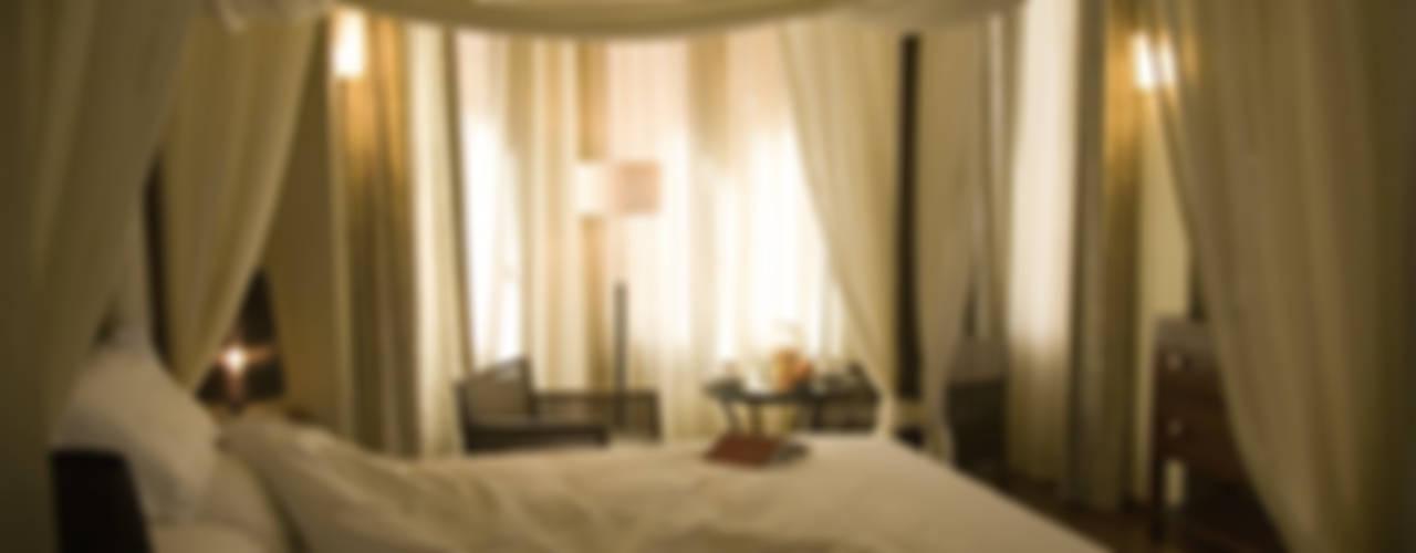 Rehabilitación de antiguo chalet para hotel con encanto Hoteles de estilo clásico de ARQUIGESTIÓN ARAGÓN S.L.P. Clásico