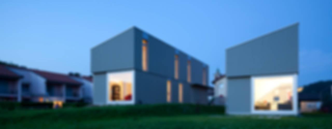Minimalistische Häuser von Cattaneo Brindelli architetti associati Minimalistisch