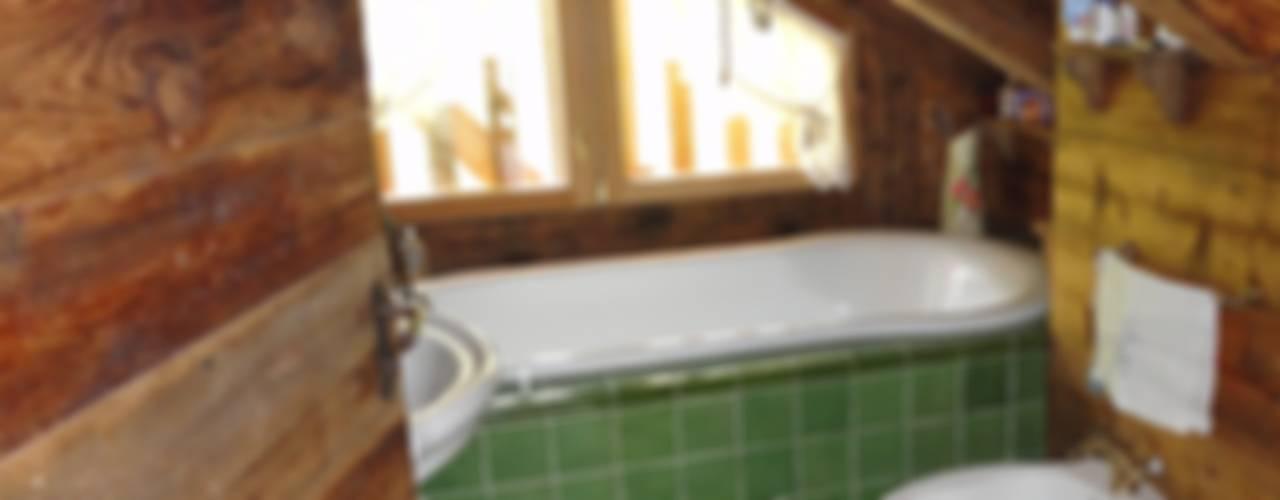 Salle de bain rustique par zanella architettura Rustique