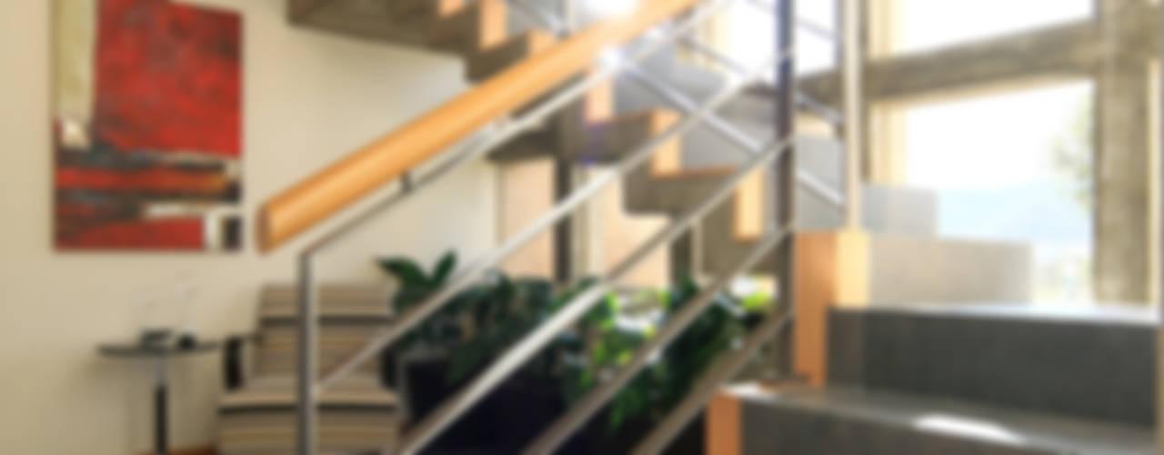 Modern corridor, hallway & stairs by Arquiplan Modern