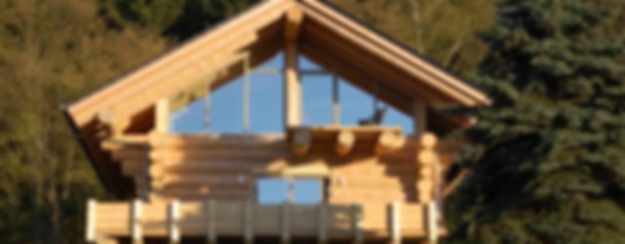 Дома в эклектичном стиле от eb Massivhaus Deutschland GmbH Эклектичный