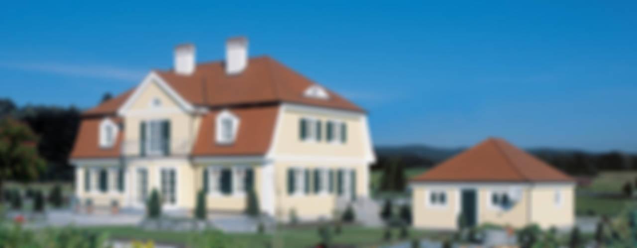 Traditionelle Landhausvilla von Bau-Fritz GmbH & Co. KG Landhaus