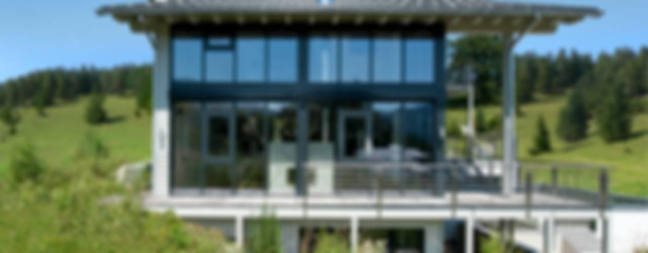 Casas de estilo  por Bau-Fritz GmbH & Co. KG