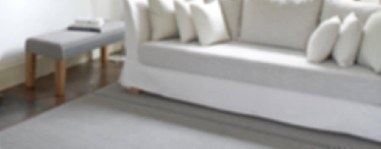 Salas de estar  por Roger Oates Design