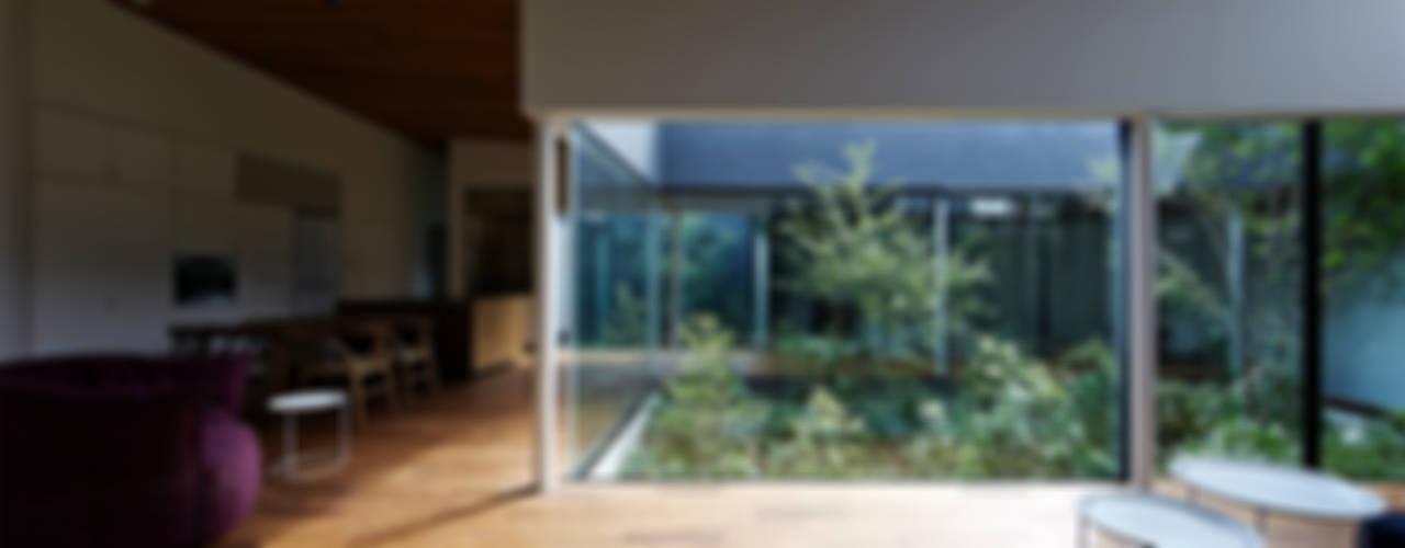 House in Higashimurayama Modern style gardens by 石井秀樹建築設計事務所 Modern