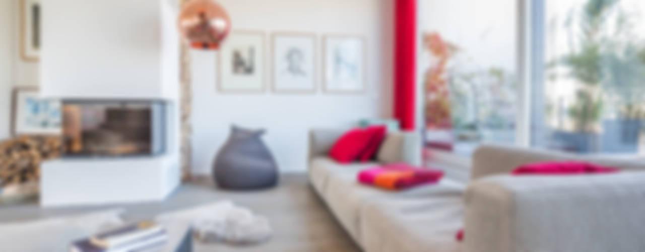 Salas de estar  por ZOOMARCHITEKTEN