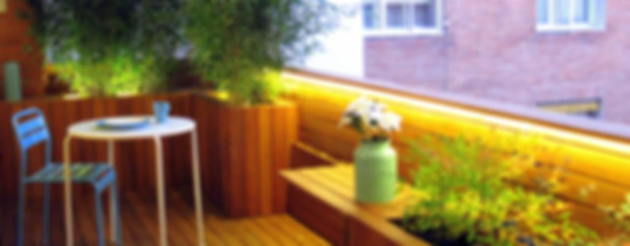 #terrazaDUQUE Balcones y terrazas de estilo moderno de +2 Moderno