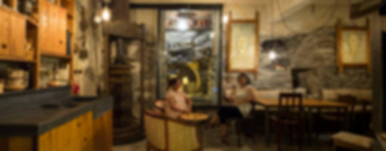 Riqualificazione di un frantoio e locale Birrificio di Manrico Mazzoli Architetto Rustico