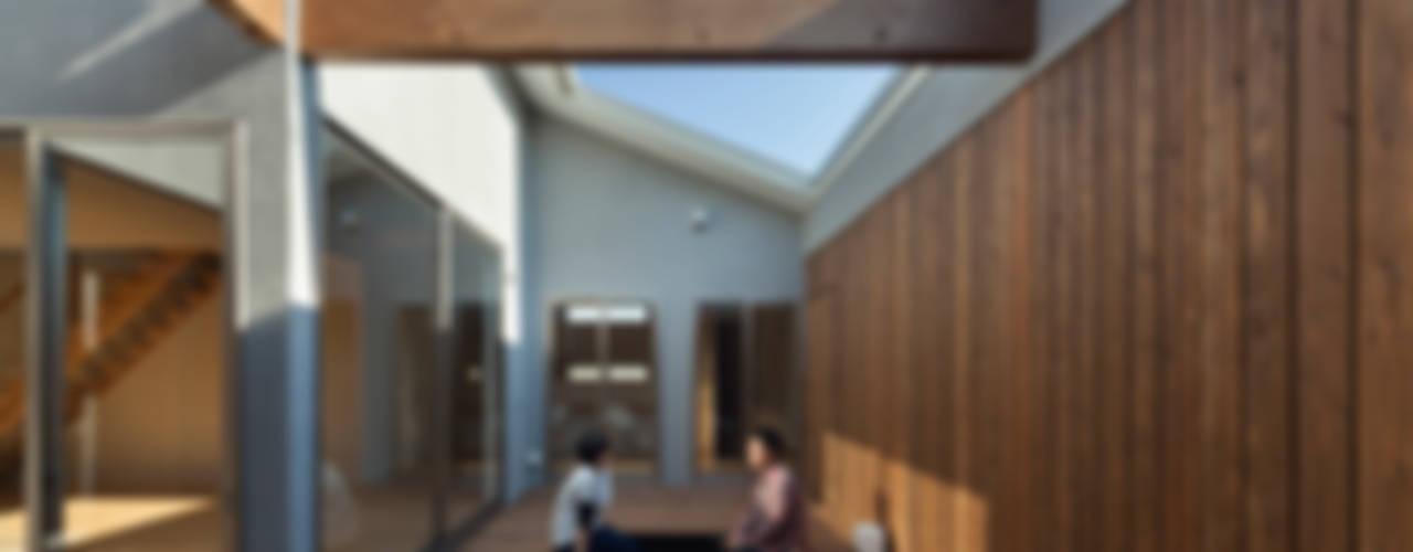 TOHKOU HOUSE: 松岡健治一級建築士事務所が手掛けた庭です。,ミニマル