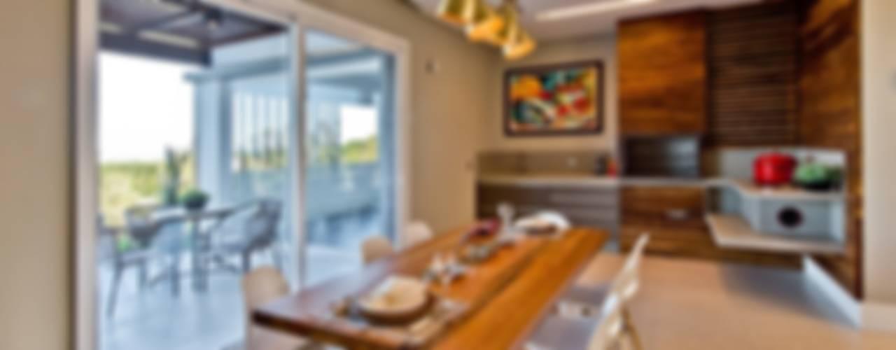 Casa no Campeche Salas de jantar modernas por Espaço do Traço arquitetura Moderno