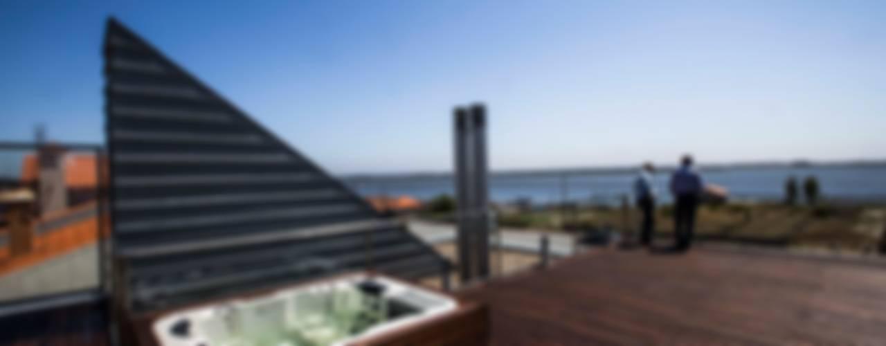 Casa VA: Casas  por Atelier Lopes da Costa