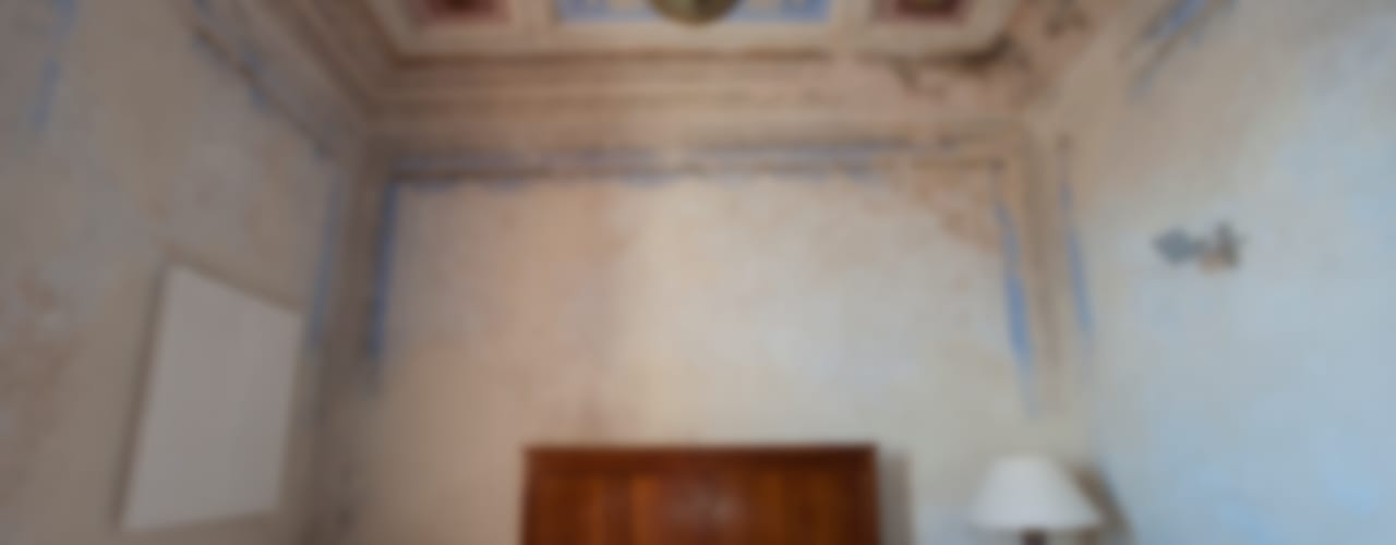 Ristrutturazione Palazzetto ottocentesco – Sorso 2011. Camera da letto moderna di Officina29_ARCHITETTI Moderno