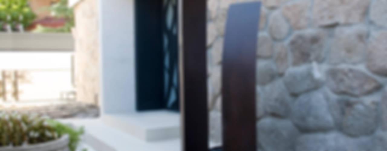 Paredes y pisos de estilo rústico de IPUNTO INTERIORISMO Rústico