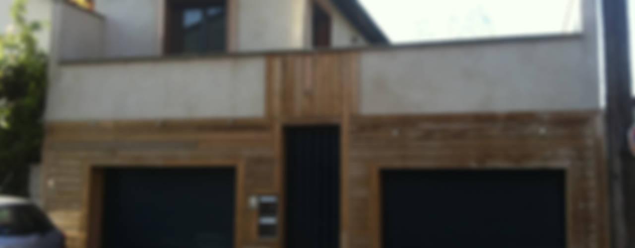 Garajes y galpones de estilo minimalista de BuroBonus Minimalista