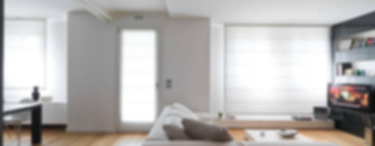 Minimalistische woonkamers van SANSON ARCHITETTI Minimalistisch