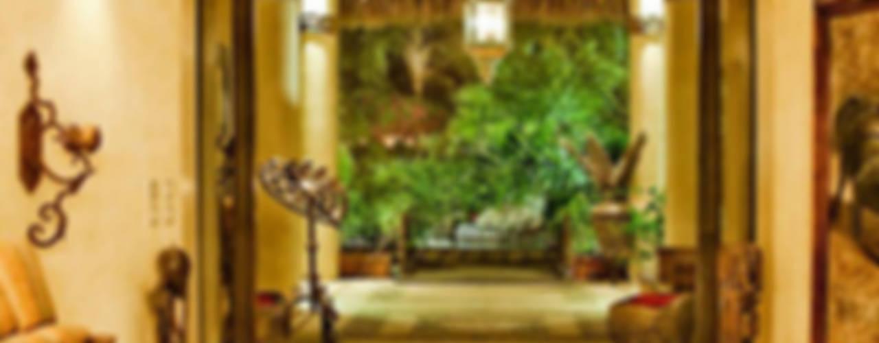 Paredes e pisos tropicais por BR ARQUITECTOS Tropical