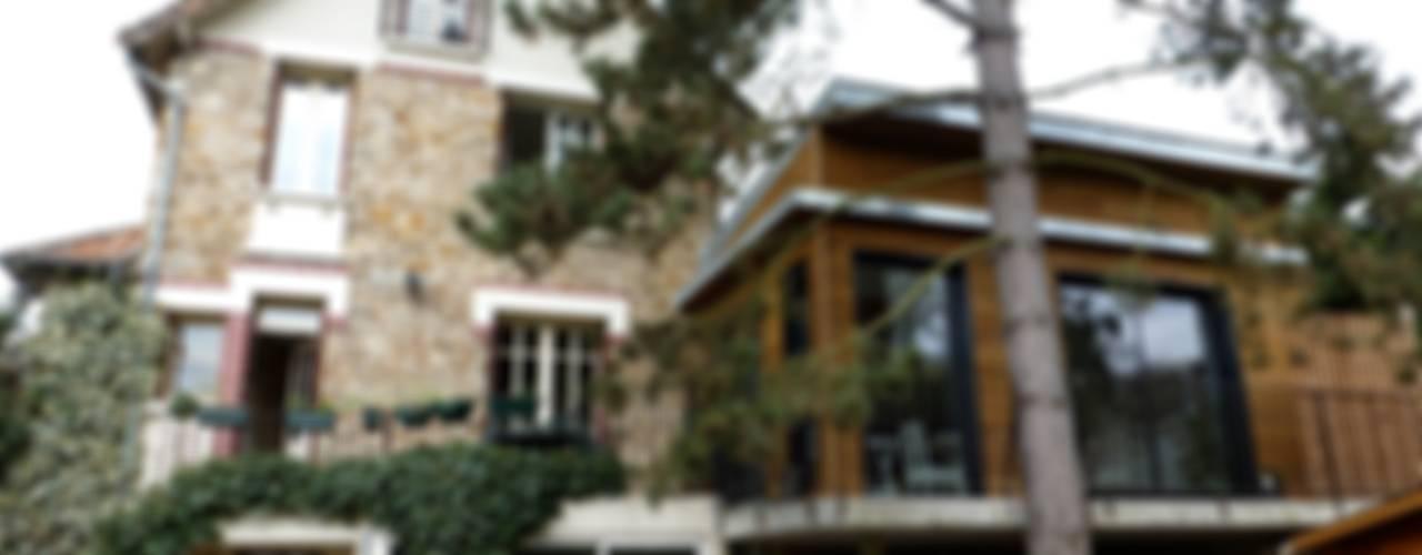 extension sur pilotis / ile de france Maisons minimalistes par karine penard Minimaliste