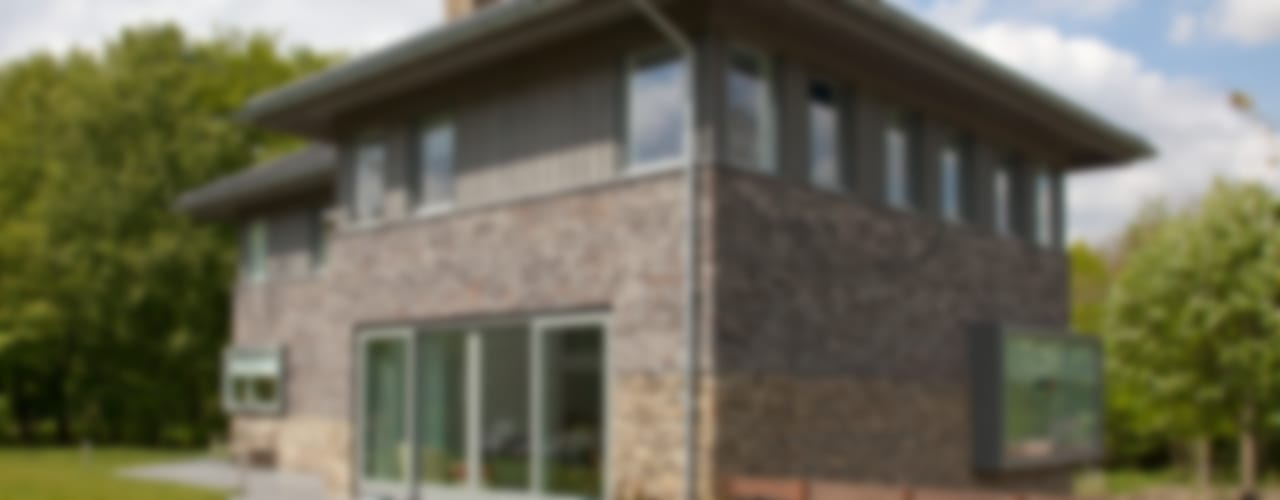 Moderne villa:  Huizen door Archstudio Architecten | Villa's en interieur,