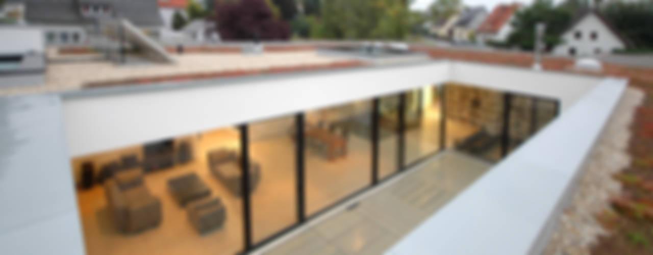 Casas de estilo  por Osterwold°Schmidt EXP!ANDER Architekten, Moderno