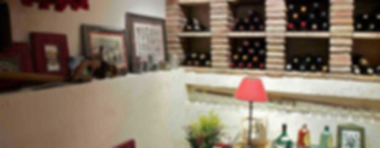 Cave à vin rustique par Urbana Interiorismo Rustique