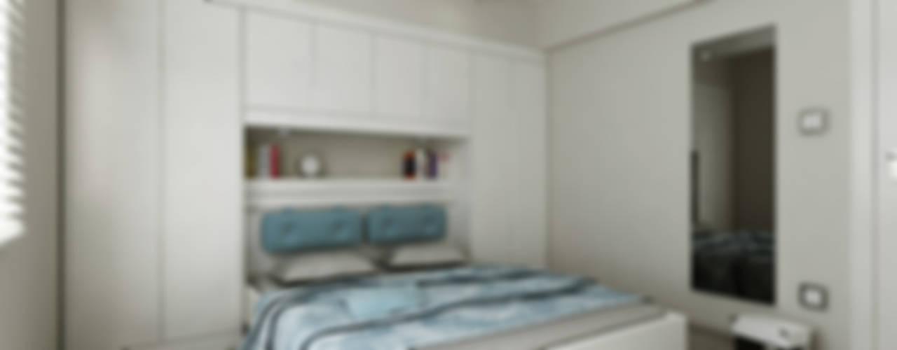Camera da letto moderna di Niyazi Özçakar İç Mimarlık Moderno