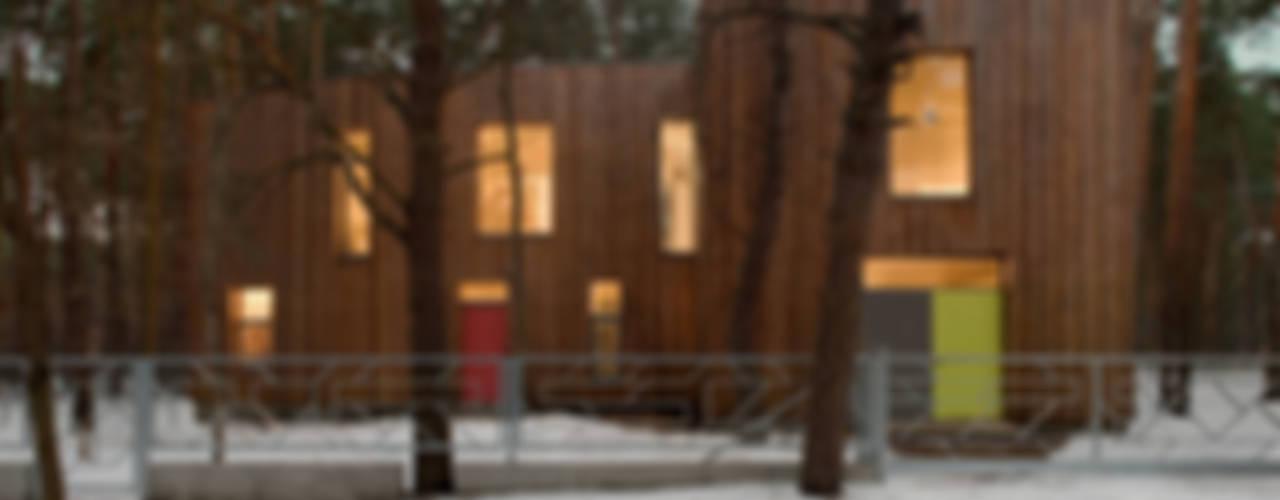 Dom w Józefowie: styl , w kategorii Domy zaprojektowany przez ANONIMOWI ARCHITEKCI,Minimalistyczny