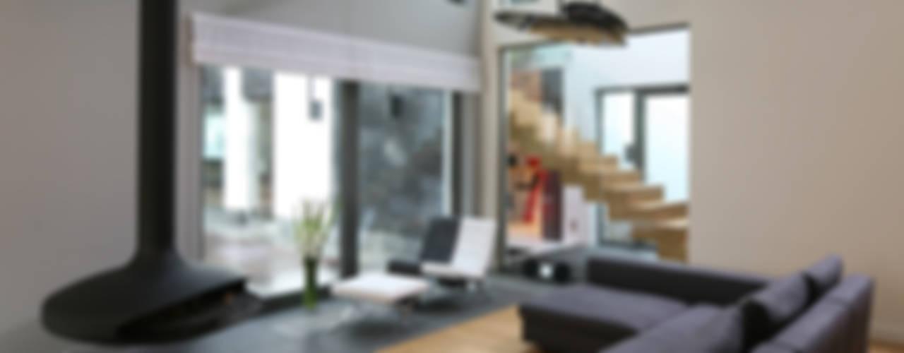 Dom w Legionowie Minimalistyczny salon od living box Minimalistyczny