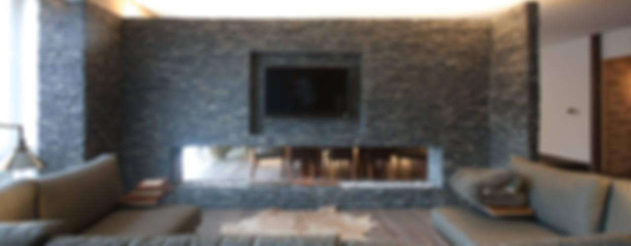 Departamento DL : Salas de estilo  por kababie arquitectos