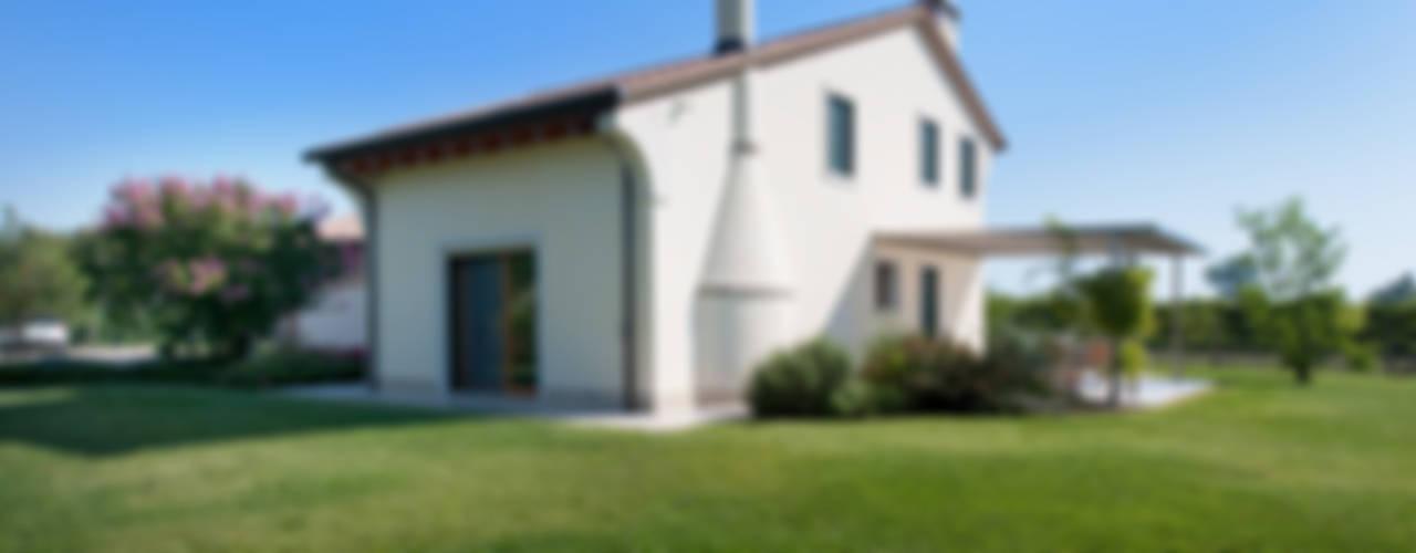 Casas de estilo clásico de Lormet Clásico