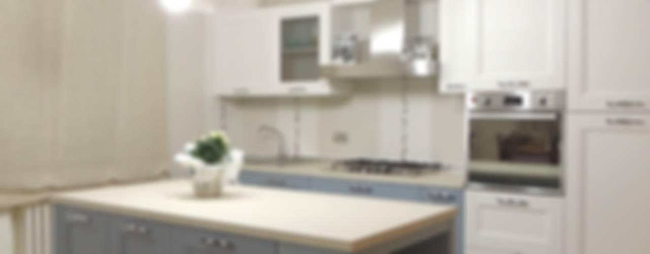 Civile abitazione con recupero pezzi preesistenti di Nadia Moretti Moderno