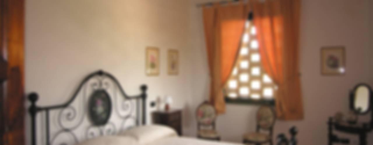 Ristrutturazione ex fienile in civile abitazione Camera da letto in stile rustico di Studio Tecnico MB architettura Rustico