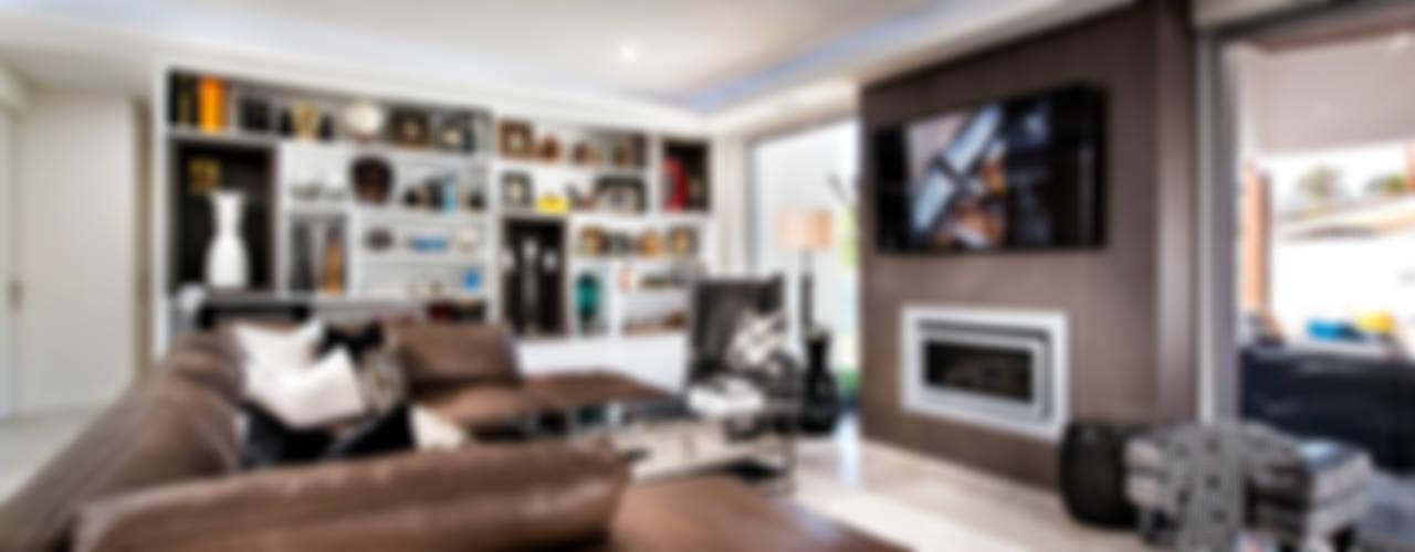 Living Rooms Family Rooms Eklektyczny salon od Moda Interiors Eklektyczny