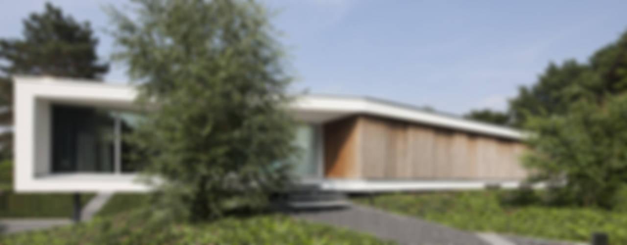 Modern houses by Lab32 architecten Modern