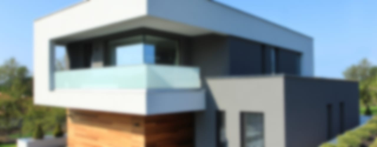 Modern houses by STRUKTURA Łukasz Lewandowski Modern