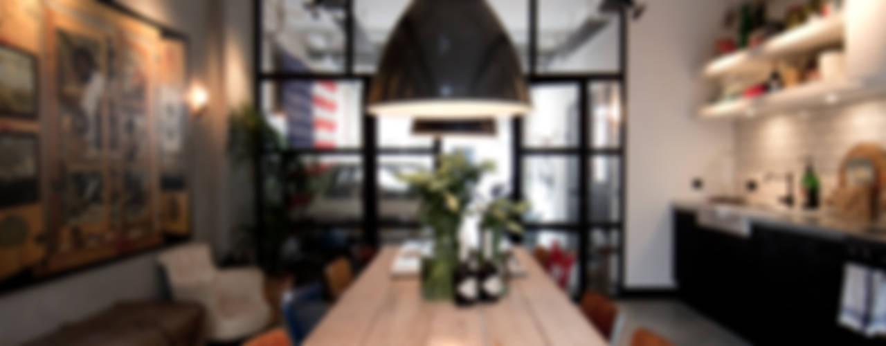 Salle à manger industrielle par BRICKS Studio Industriel