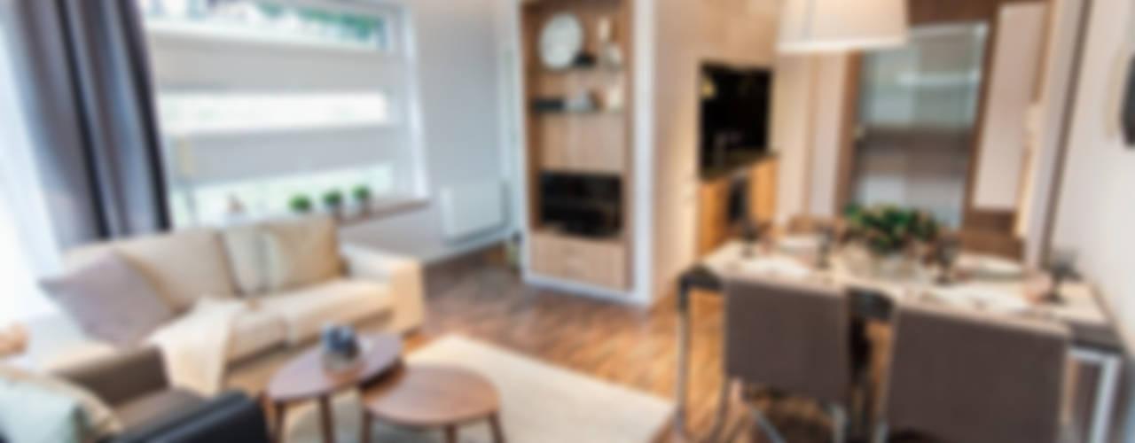 Apartament pokazowy Merint Village w Wiśle: styl , w kategorii Salon zaprojektowany przez Goryjewska.Górnisiewicz ,Nowoczesny