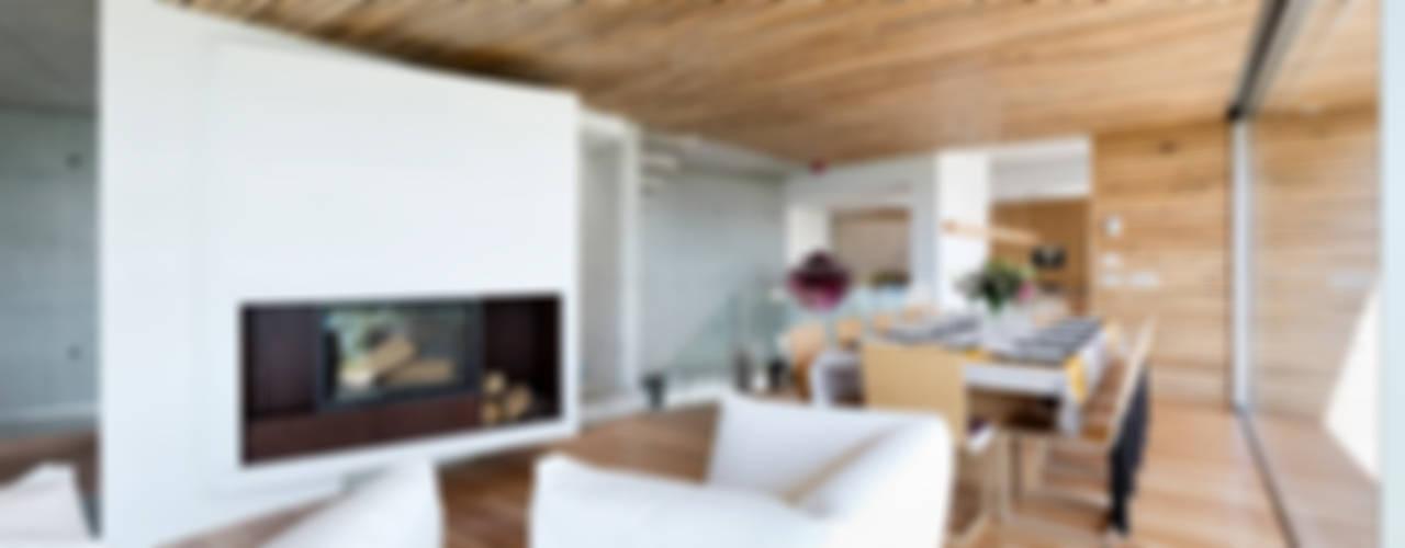 Dezanove House Salones modernos de Inaki Leite Design Ltd. Moderno