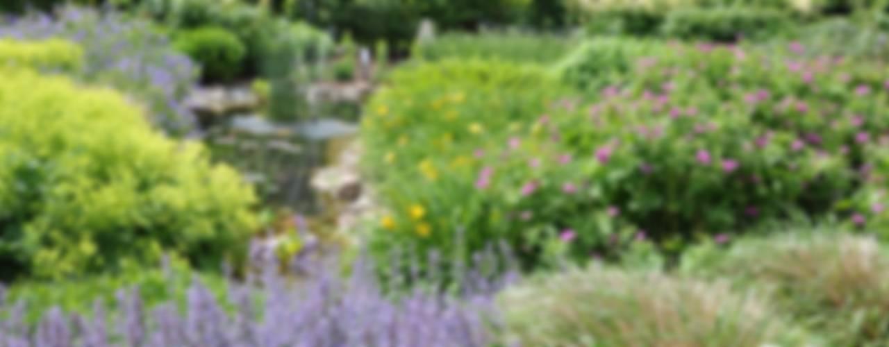 Wiejski ogród od Ambiente Gartengestaltung Wiejski