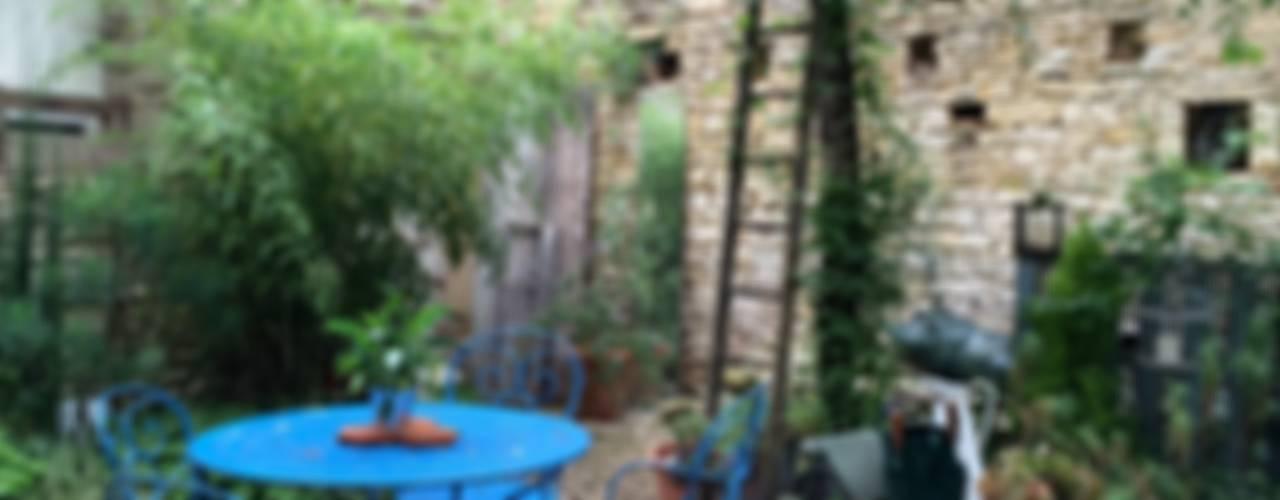 Сад в стиле модерн от Atelier d'Ersu & Blanco Модерн