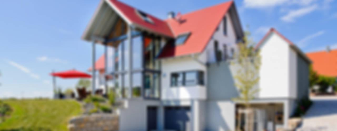Wiejskie domy od Achtergarde + Welzel Architektur + Interior Design Wiejski