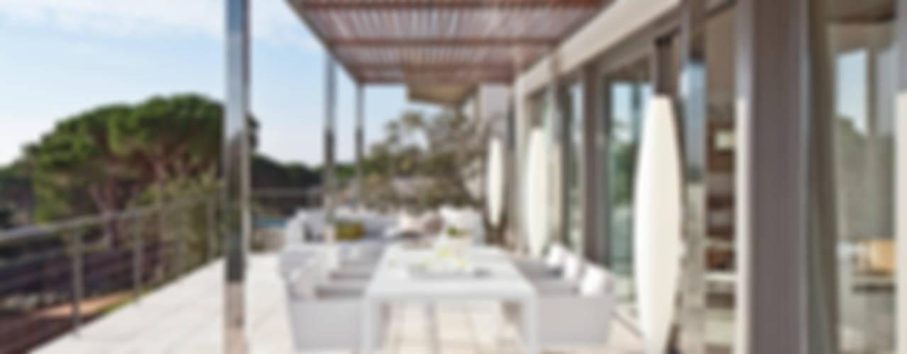 Balcones y terrazas mediterráneos de IND Archdesign Mediterráneo