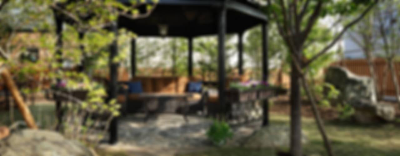 老人ホーム ホスピスの庭: 秦造園が手掛けた庭です。,オリジナル