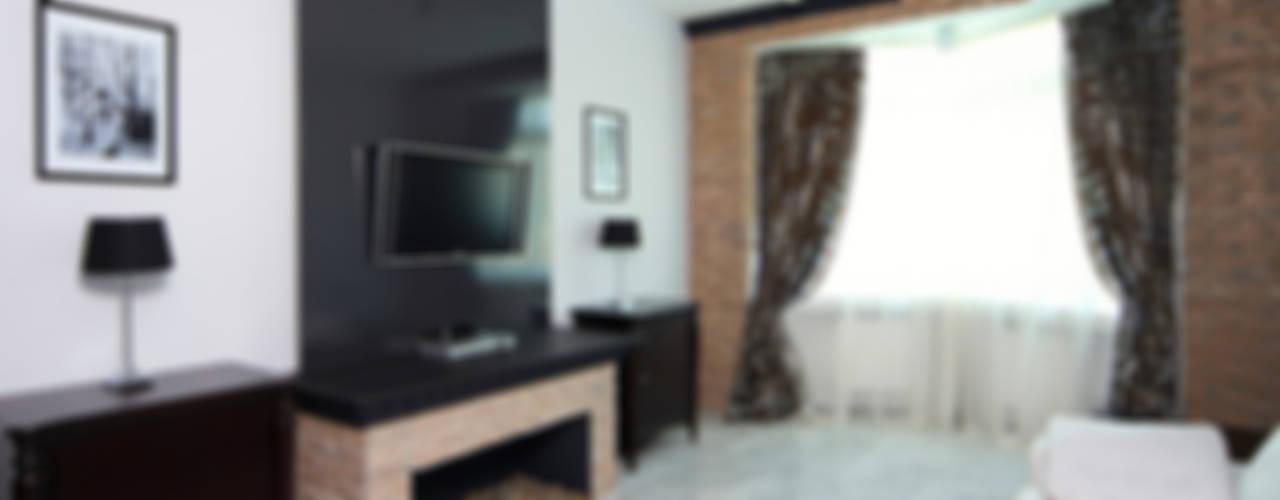 Черно-белое кино или ловкий лофт?: Гостиная в . Автор – anydesign, Лофт