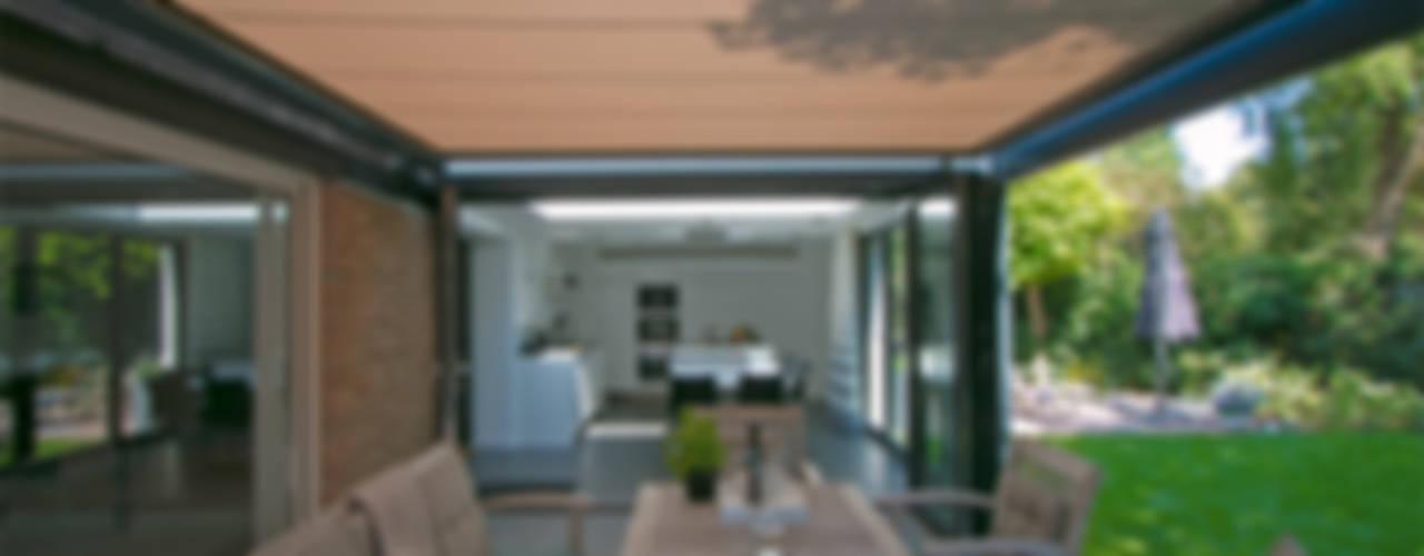 Aanbouw aan villa Moderne huizen van Hoope Plevier Architecten Modern