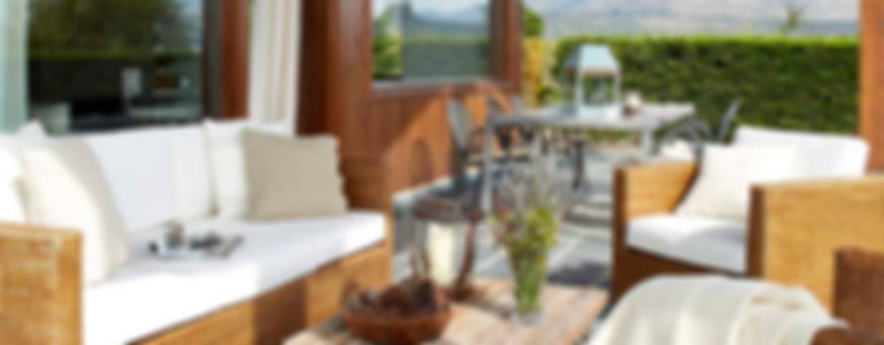 Casa en La Cerdanya. 2013 Balcones y terrazas de estilo rústico de Deu i Deu Rústico